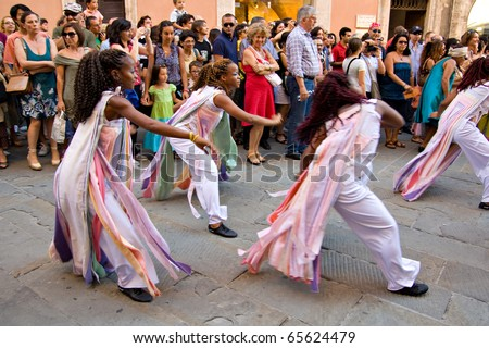 PERUGIA, ITALY - JULY 10: Projecto Axe' (music, dance and capoeira) from Brazil in parade at Umbria Jazz Festival - July 10, 2010 in Perugia, Italy - stock photo