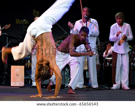 PERUGIA, ITALY - JULY 12: Projecto Axe' (music, dance and capoeira) from Brazil on stage at Umbria Jazz Festival - July 12, 2010 in Perugia, Italy