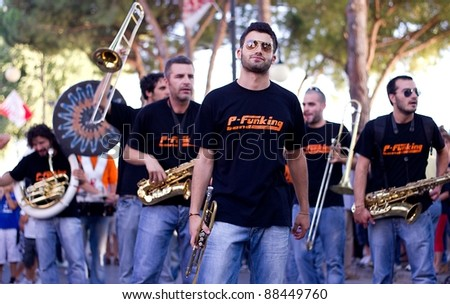 """PERUGIA, ITALY - JULY 29: The street big band called """"P-Funking"""" play music during the """"Trasimeno Blues Festival"""" on July 29, 2011 in Perugia (Italy) - stock photo"""