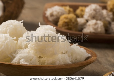 Peruvian cocadas, a traditional coconut dessert sold usually on the streets, made of grated coconut and white or brown sugar (Selective Focus, Focus on the front of the cocadas)