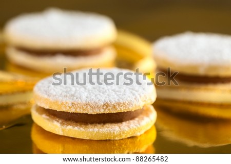 Peruvian cookies called alfajores filled with a caramel-like cream called manjar (Selective Focus, Focus on front upper edge of the first cookie) - stock photo