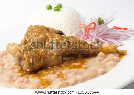 "Peruvian culinary ""frejoles con seco"" it is  beans with lamb"