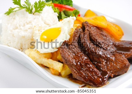 """Peruvian  food beef, whit potatoes, egg, and rice. """"Lomo a lo pobre"""" - stock photo"""