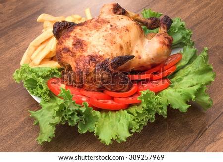"""Peruvian food: Grilled chicken """"Pollo a la Brasa"""". - stock photo"""