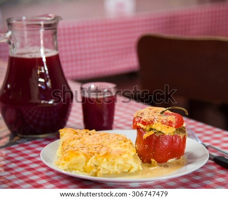 "peruvian food: ""Rocoto relleno"" a  filled pepper with meal and cheese. - stock photo"
