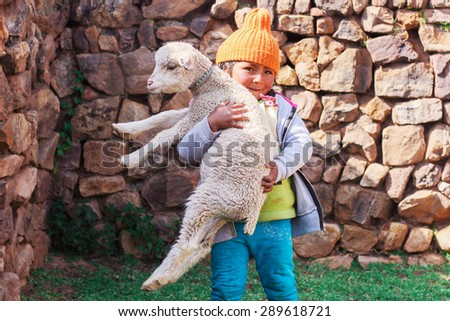 Peruvian girl with a sheep - stock photo