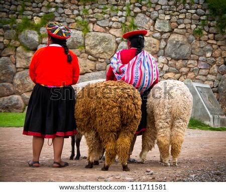Peruvian Girls and Alpacas at Sacsayhuaman, Cusco Peru - stock photo