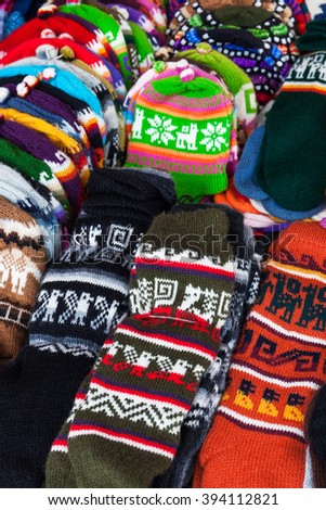 peruvian hats and socks in a street market - stock photo