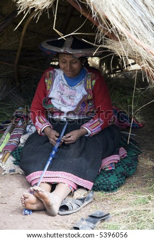 Peruvian Inca Women in Traditional Dress Weaving - stock photo