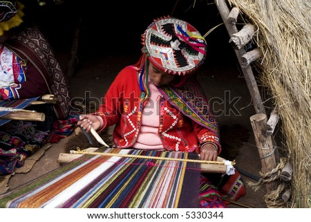 Peruvian Indian Woman in Traditional Dress Weaving - stock photo