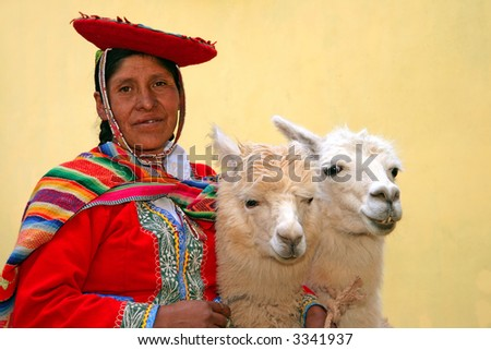 Peruvian lady in authentic dress with two lamas in Cusco, Peru. - stock photo