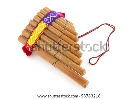 Peruvian pan flute or pipe isolated over white - stock photo
