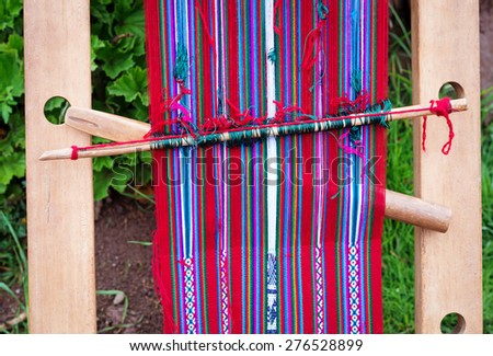 Peruvian weaving at  lake Titicaca on Taquile Island in Peru - stock photo