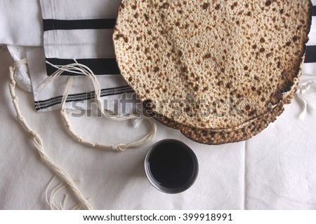 Pesah (jewish Passover holiday) with wine and matza - stock photo