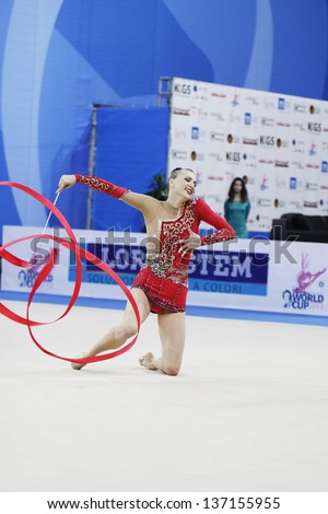 PESARO, ITALY - APRIL 28: Ganna Rizatdinova from Ukraine performs with ribbon during the rhythmic gymnastic World Cup on April 28, 2013 in Pesaro, Italy