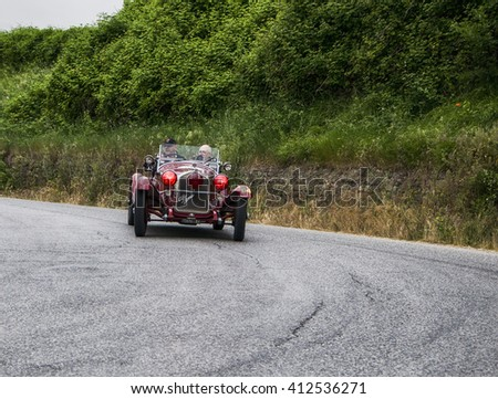 Pesaro, Italy - May 15, 2015:ALFA ROMEO 6C 1750 GS Spider Zagato 1930 in nidentified crew on an old racing car in rally Mille Miglia 2015 the famous italian historical race (1927-1957)