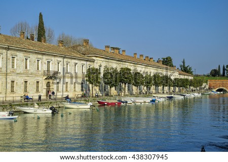 PESCHIERA DEL GARDA, ITALY - MARCH 26: The main canal in Peschiera del Garda, Garda Lake district, Italy