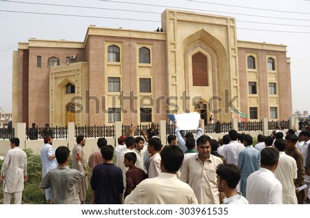 PESHAWAR, PAKISTAN - AUG 07: Activists of Tehreek-e-Insaf are demonstrating in favor of their leader Zia Ullah Afridi on his arrival at Accountability Court on August 07, 2015 in Peshawar.