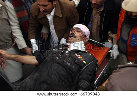 PESHAWAR, PAKISTAN - DEC 06: A man injured in suicide bomb attacks in Mohmand region being shifted to hospital on December 06, 2010 in Peshawar, Pakistan.