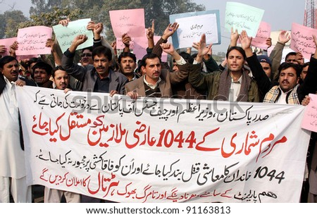 PESHAWAR, PAKISTAN - DEC 20: Census department employees are protesting in favor of their demands during a demonstration at Peshawar press club on December 20, 2011 in Peshawar, Pakistan. - stock photo
