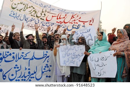 PESHAWAR, PAKISTAN, DEC 28: Members of National Labor Federation (NLF) chant slogans in favor of their demands during protest demonstration in Peshawar on Wednesday, December 28, 2011. - stock photo