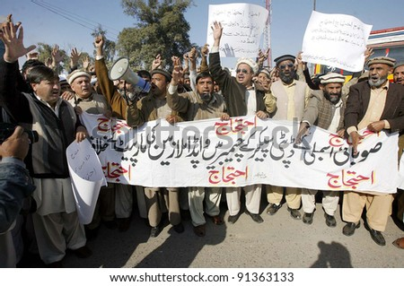 PESHAWAR, PAKISTAN - DEC 23: Members of WAPDA Hydro Electric Central Labor Union are protesting in favor of their demands during demonstration  on  December 23, 2011in Peshawar. - stock photo