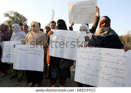 PESHAWAR, PAKISTAN - JAN 11: Activists of Human Dignity Organization from Swat are protesting in favor of their demands during a demonstration at Peshawar press club on January 11, 2011in Peshawar. - stock photo