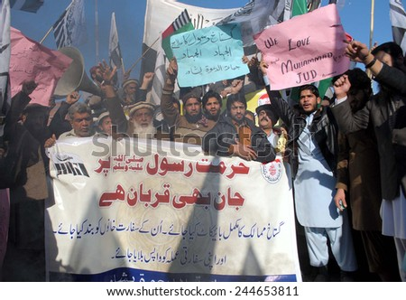 PESHAWAR, PAKISTAN - JAN 16: Jamat-ud-Dawah are protesting against  publication of blasphemous caricatures in French Charlie Hebdo, during a demonstration  on January 16, 2015 in Peshawar.  - stock photo
