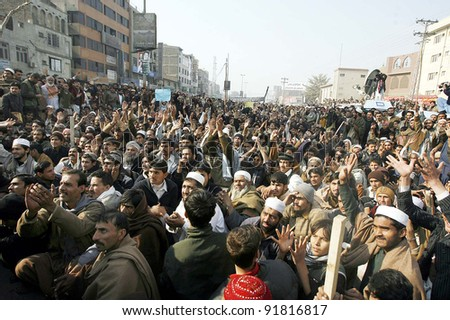 PESHAWAR, PAKISTAN, JAN 02: Supporters of rickshaws drivers gather during their protest demonstration in favor of their demands at GT.road in Peshawar on Monday, January 02, 2012. - stock photo