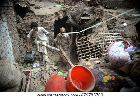 PESHAWAR, PAKISTAN - JUL 13: View of damages caused by heavy rain after downpour of monsoon season on July 13, 2017 in Peshawar.
