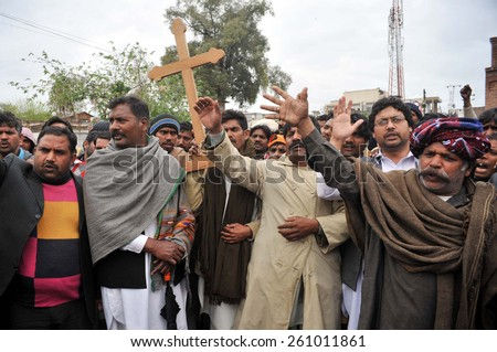 PESHAWAR, PAKISTAN - MAR 16: Christian Community chant slogans against Twin blasts targeted the Roman Catholic Church and Christ Church in Youhanabad area of Lahore on March 16, 2015 in Peshawar.  - stock photo