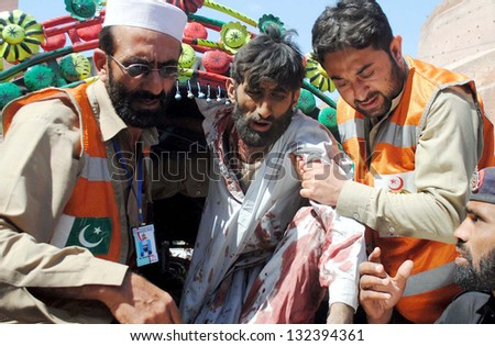 PESHAWAR, PAKISTAN - MAR 21: Victim of bomb explosion at the Jalozai camp in  Nowshera being shifted at Lady Reading Hospital for treatment, on March 21, 2013 in Peshawar. at least fifteen killed.