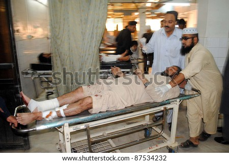 PESHAWAR, PAKISTAN - OCT 27: An injured man, who was injured in explosion at Rampura Bazaar, being treated at Lady Reading hospital (LRH) on October 27, 2011 in Peshawar.