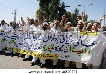 PESHAWAR, PAKISTAN - OCT 12: Supporters of WAPDA Hydro Electric Central Labor Union chant slogans in favor of their demands during protest demonstration on October 12, 2011i n Peshawar, Pakistan. - stock photo