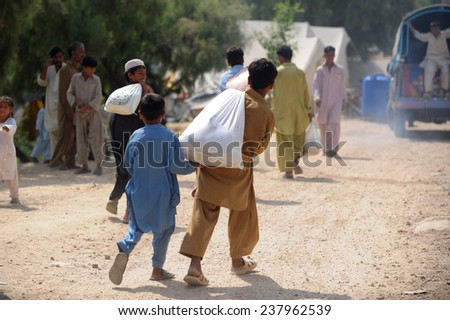 PESHAWAR, PAKISTAN - SEPT 09: Flood victims assistance  Peshawar, Pakistan on September 09, 2010.