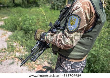 PESKY VILLAGE NEAR DONETSK CITY, UKRAINE July 28, 2015: Ukrainian soldiers on patrol   - stock photo