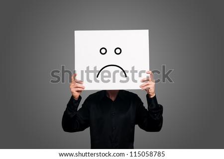 pessimist negative on gray background - stock photo