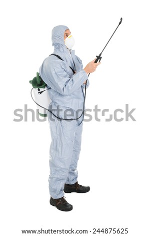 Pest Control Worker In Protective Workwear And Mask Spraying Pesticides Over White Background - stock photo