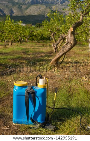 Pesticide sprayer against the background of an orchard - stock photo