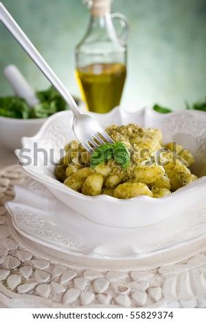 pesto gnocchi on dish - stock photo