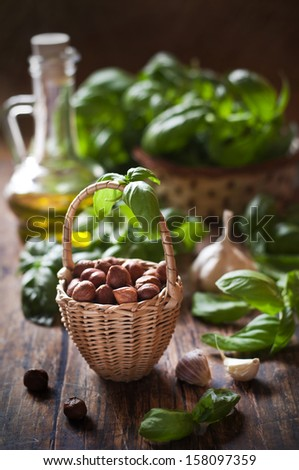 pesto ingredients on wooden table - stock photo