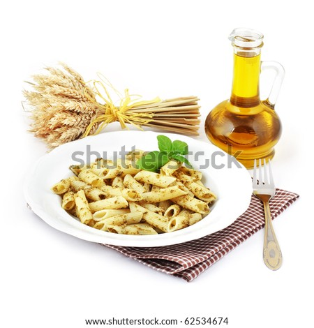 Pesto plate with olive bottle on white background. - stock photo