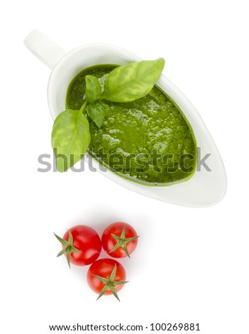 Pesto sauce and cherry tomatoes. View from above. Isolated on white background - stock photo