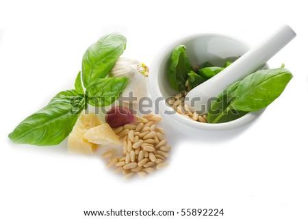 pesto sauce over spoon with ingredients - stock photo