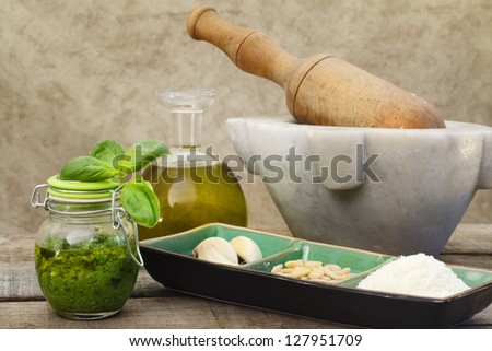 pesto sauce with mortar and pestle