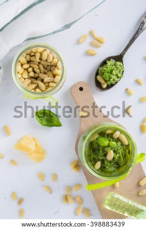 Pesto sauce with pine nuts and parmesan cheese basil top view - stock photo