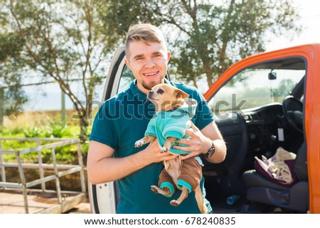 pet, domestic animal, season and people concept - Portrait of happy man with his dog walking outdoors