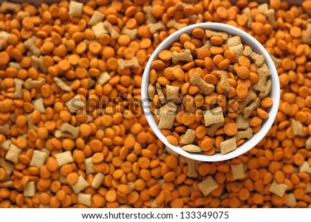 pet food in the dog dish with background of pet food out focus. - stock photo