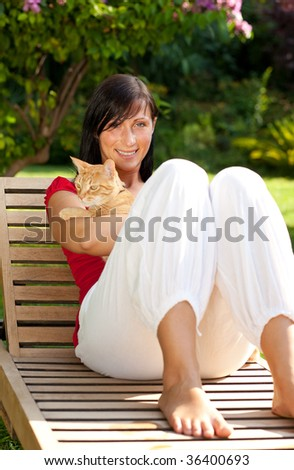 Pet loving anti allergy girl sitting on wooden garden chair - stock photo