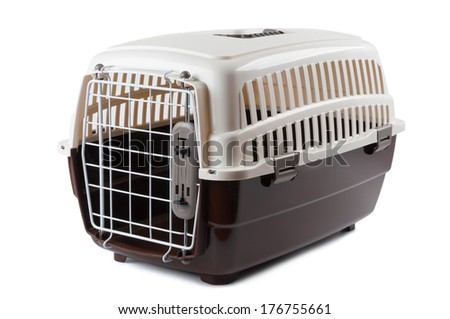 Pet travel plastic carrier isolated on white - stock photo
